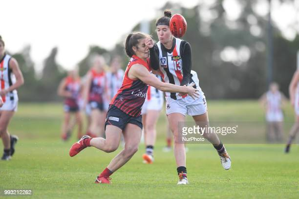 Courtney Munn of the Southern Saints gets a handball out during the VFL Women's round 9 game between the Casey Demons and Southern Saints at Casey...