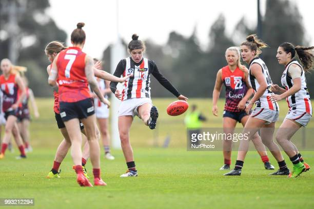 Courtney Munn of the Southern Saints kicks the ball during the VFL Women's round 9 game between the Casey Demons and Southern Saints at Casey Fields...