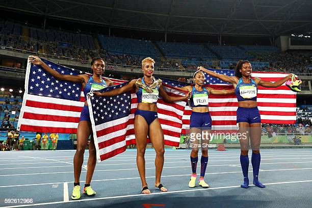 Courtney Okolo Natasha Hastings Allyson Felix and Phyllis Francis of the United States react after winning gold in the Women's 4 x 400 meter Relay on...