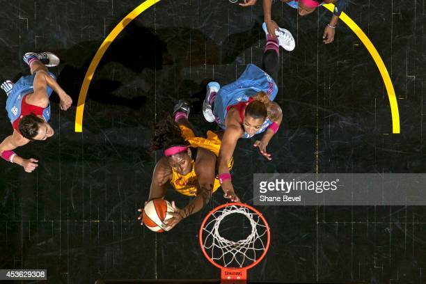 Courtney Paris of the Tulsa Shock shoots the ball against Erika de Souza of the Atlanta Dream during the WNBA game on July 29 2014 at the BOK Center...