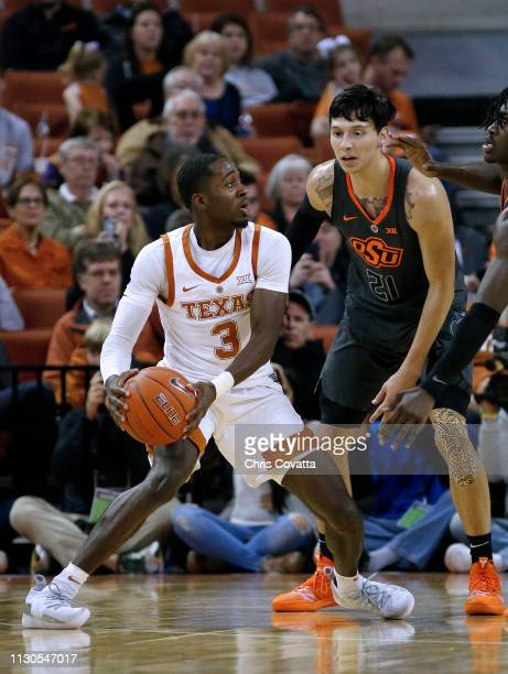 Courtney Ramey of the Texas Longhorns looks to pass the ball around Lindy Waters III of the Oklahoma State Cowboys at The Frank Erwin Center on...