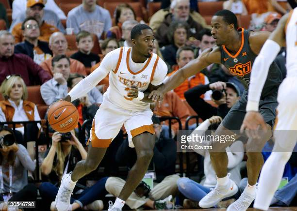 Courtney Ramey of the Texas Longhorns moves with the ball as Cameron McGriff of the Oklahoma State Cowboys defends him at The Frank Erwin Center on...