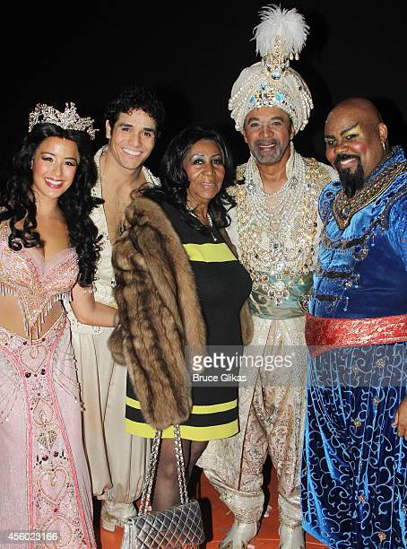 Courtney Reed as 'Jasmine' Adam Jacobs as 'Aladdin' Aretha Franklin Clifton Davis as 'The Sultan' and James Monroe Iglehart as 'The Genie' pose...