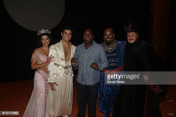 Courtney Reed as 'Jasmine' Adam Jacobs as 'Aladdin' Tituss Burgess James Monroe Iglehart as 'Genie' and Jonathan Freeman as 'Jafar' pose backstage at...