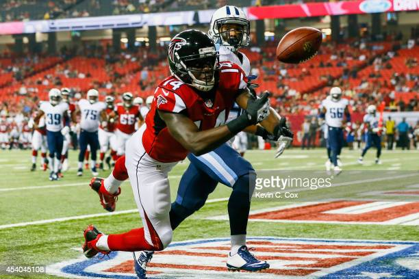 Courtney Roby of the Atlanta Falcons attempts to catch a pass in the endzone against Winston Wright of the Tennessee Titans in the second half of a...