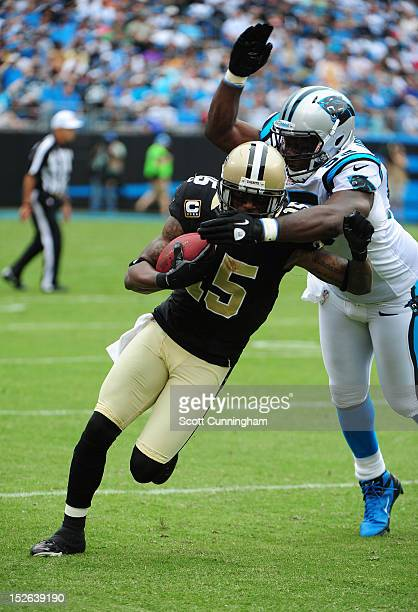 Courtney Roby of the New Orleans Saints runs with a catch against Charles Johnson of the Carolina Panthers at Bank of America Stadium on September 16...