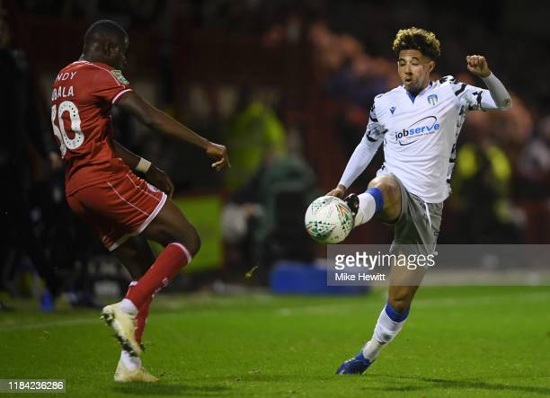 Courtney Senior of Colchester United battles for possession with Beryly Lubala of Crawley Town during the Carabao Cup Round of 16 match between...