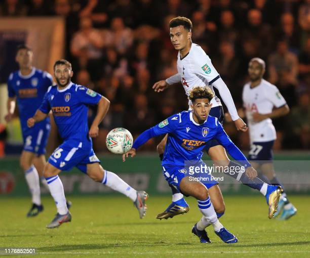 Courtney Senior of Colchester United challenges for the ball with Dele Alli of Tottenham Hotspur during the Carabao Cup Third Round match between...