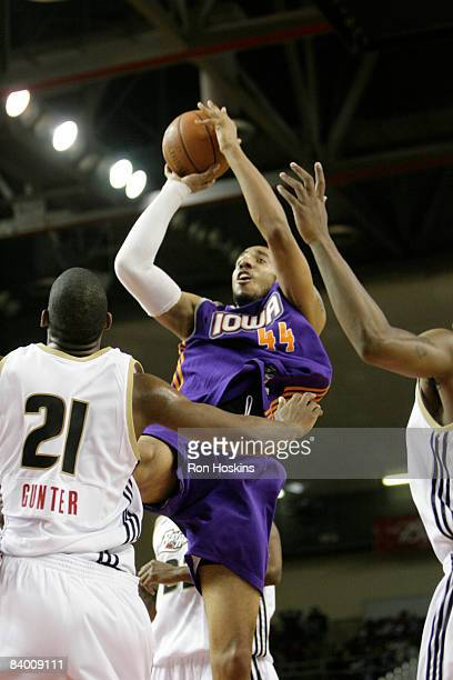Courtney Sims of the Iowa Energy shoots over Jarvis Gunter of the Erie BayHawks at Tullio Arena on December 11 2008 in Erie Pennsylvania NOTE TO USER...