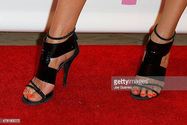 5c088061ee Courtney Sixx, shoe detail, hosts a charity shopping event at ...