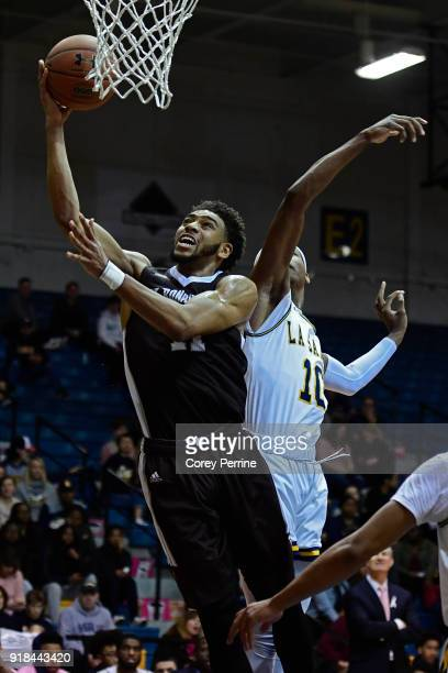 Courtney Stockard of the St Bonaventure Bonnies drives to the basket against Isiah Deas of the La Salle Explorers during the first half at Tom Gola...