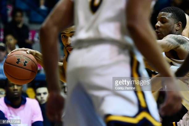 Courtney Stockard of the St Bonaventure Bonnies is guarded by Amar Stukes of the La Salle Explorers during the first half at Tom Gola Arena on...