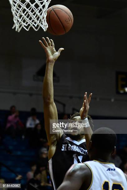 Courtney Stockard of the St Bonaventure Bonnies scores as Saul Phiri of the La Salle Explorers looks on during the first half at Tom Gola Arena on...