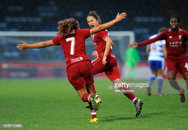 Courtney Sweetman-Kirk of Liverpool celebrates with teammate Jessica Clarke after scoring her team's second goal during the FA Women's Super League...