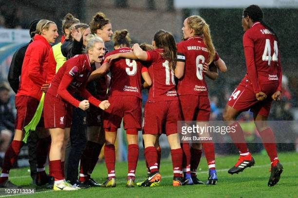 Courtney Sweetman-Kirk of Liverpool celebrates with teammates after scoring her team's second goal during the FA Women's Super League match between...