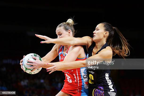 Courtney Tairi of the Magic competes with Kimberlee Green of the Swifts during the ANZ Championship Minor Semi Final match between the Sydney Swifts...