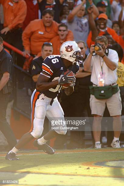Courtney Taylor of the Auburn Tigers hauls in the winning touchdown against the LSU Tigers in a game on September 18 2004 at JordanHare Stadium in...
