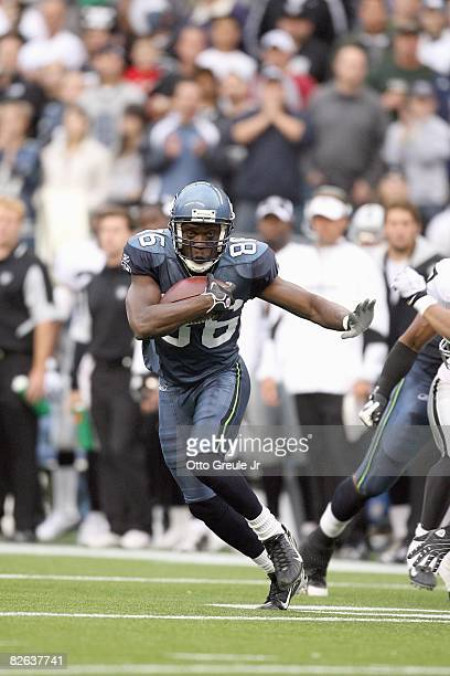 Courtney Taylor of the Seattle Seahawks carries the ball during the game against the Oakland Raiders at Qwest Field on August 29, 2008 in Seattle,...