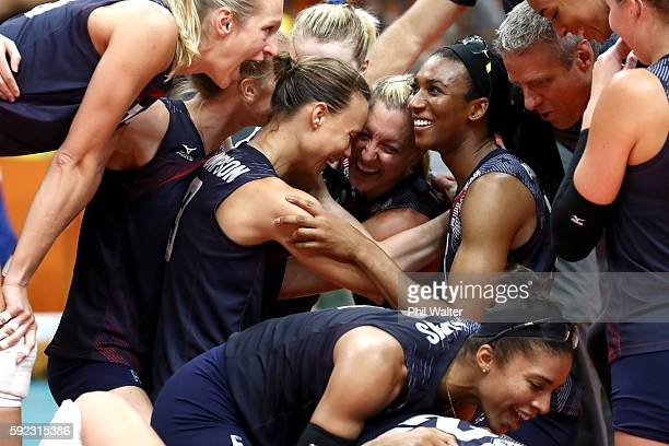Courtney Thompson Jordan LarsonBurbach and Foluke Akinradewo of United States celebrate after match point during the Women's Bronze Medal Match...