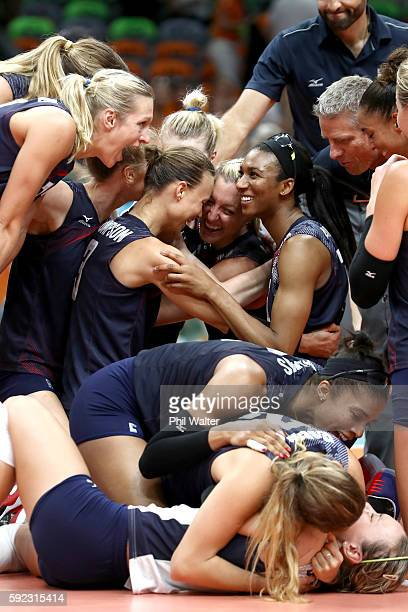 Courtney Thompson Jordan LarsonBurbach Foluke Akinradewo Rachael Adams of United States celebrate after match point during the Women's Bronze Medal...