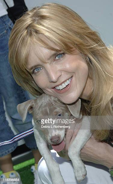 Courtney ThorneSmith with Coco during Courtney ThorneSmith Hosts Puppy Park in Central Park June 18 2005 at Central Park in New York City New York...