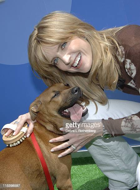 """Courtney Thorne-Smith with Mimi during Courtney Thorne-Smith Hosts """"Puppy Park"""" in Central Park - June 18, 2005 at Central Park in New York City, New..."""