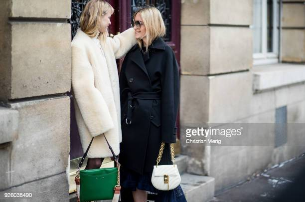 Courtney Trop and Charlotte Groeneveld wearing black coat boots Chloe bag is seen outside Chloe on March 1 2018 in Paris France