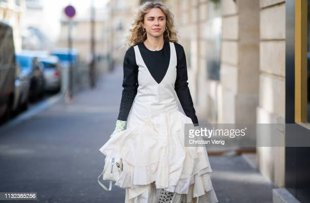 Courtney Trop is seen weairng white dress and bag outside Marques Almeida during Paris Fashion Week Womenswear Fall/Winter 2019/2020 on February 26,...