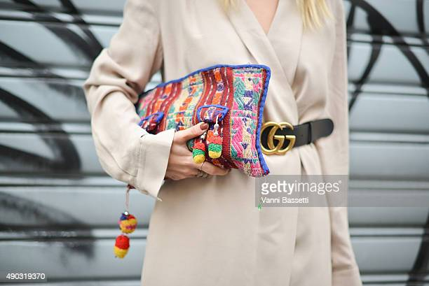 Courtney Trop poses wearing a Tylr dress Gucci belt and a vintage bag after the Marni show during the Milan Fashion Week Spring/Summer 2016 on...