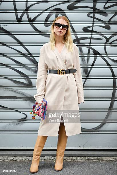 Courtney Trop poses wearing a Tylr dress Gucci belt vintage bag and Chloe boots after the Marni show during the Milan Fashion Week Spring/Summer 2016...