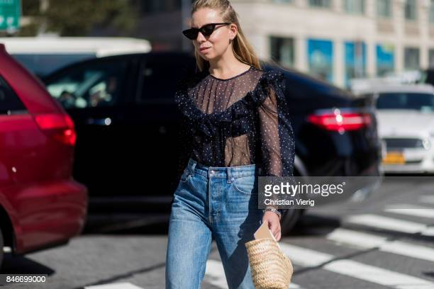 Courtney Trop wearing a sheer top seen in the streets of Manhattan outside Michael Kors during New York Fashion Week on September 13 2017 in New York...