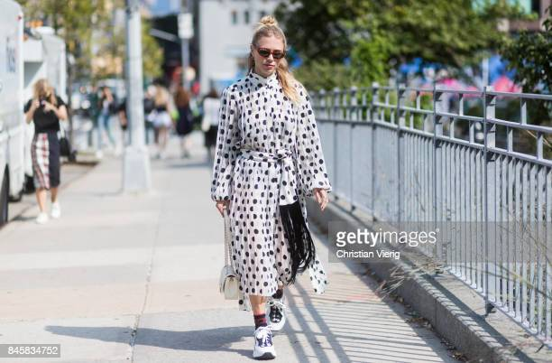 Courtney Trop wearing dress with dots seen in the streets of Manhattan outside Zimmermann during New York Fashion Week on September 11 2017 in New...