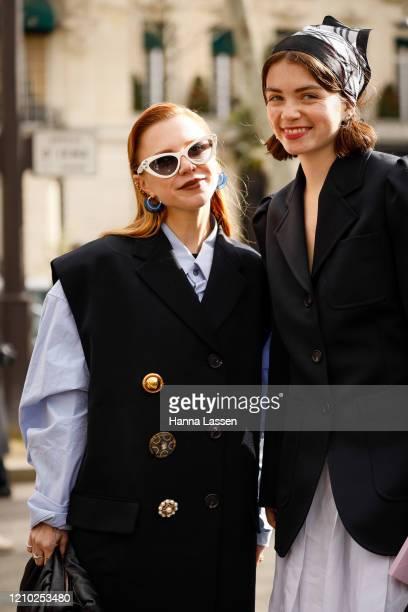 Courtney Trop wearing Miu Miu blue shirt, navy vest and white sunglasses outside the Miu Miu show during Paris Fashion Week Womenswear Fall/Winter...