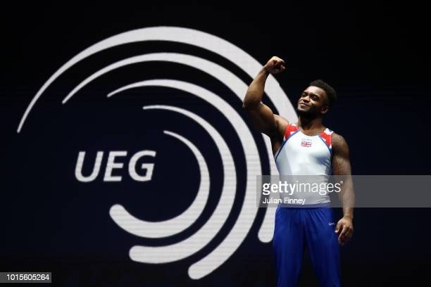 Courtney Tulloch of Great Britain celebrates at the podium before receiving his bronze medal for Vault during the Men's Gymnastics Final on Day...