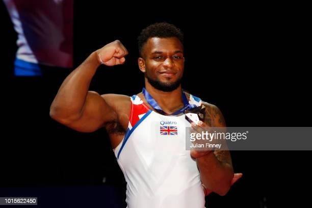 Courtney Tulloch of Great Britain pose for a photo with his bronze medal for his third place in Rings during the Men's Gymnastics Final on Day Eleven...
