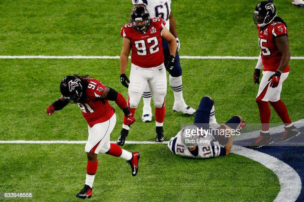 Courtney Upshaw of the Atlanta Falcons reacts after a sack on Tom Brady of the New England Patriots in the first quarter during Super Bowl 51 at NRG...
