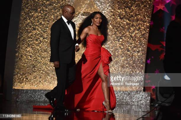 Courtney Vance and Angela Bassett walk onstage at AllStar Lineup Pays Tribute At 'Aretha A GRAMMYCelebration For The Queen Of Soul at The Shrine...