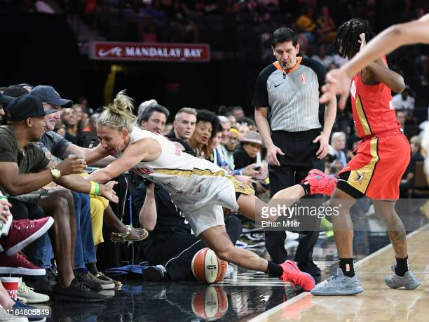 Courtney Vandersloot of Team Delle Donne crashes into fans on a sideline as she goes after a loose ball against Erica Wheeler of Team Wilson during...