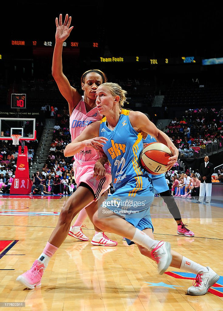 Courtney Vandersloot #22 of the Chicago Sky drives against Jasmine Thomas #5 of the Atlanta Dream at Philips Arena on August 24 2013 in Atlanta, Georgia.