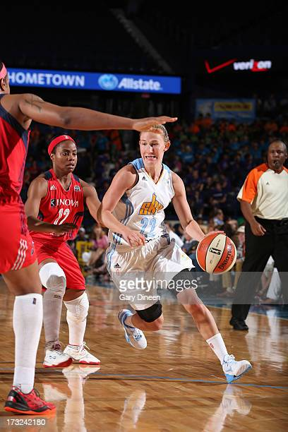 Courtney Vandersloot of the Chicago Sky drives past Ivory Latta of the Washington Mystics during the game on July 10 2013 at the Allstate Arena in...
