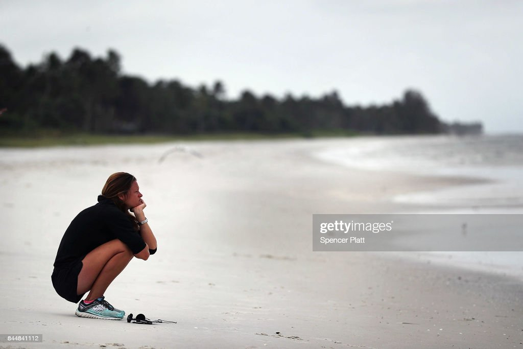 Courtney Vernon pauses on the beach in Naples before the arrival of Hurricane Irma into Southwest Florida on September 9, 2017 in Naples, Florida. The Naples area could begin to feel hurricane-force winds from Irma by 11 a.m. Sunday and experience wind gusts over 100 mph from Sunday through Monday.