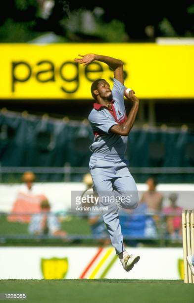 Courtney Walsh of the West Indies bowls during a Benson and Hedges World Series match against England at Woolloongabba in Brisbane, Australia. \...