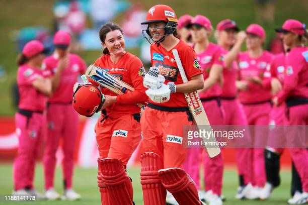 Courtney Webb of the Renegades celebrates victory with Molly Strano of the Renegades during the Women's Big Bash League match between the Sydney...