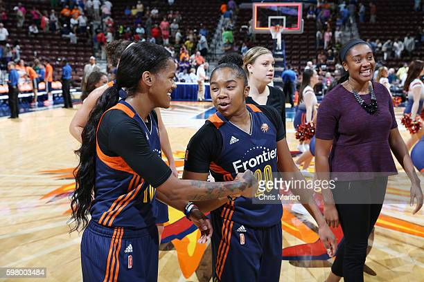 Courtney Williams and Alex Bentley of the Connecticut Sun celebrate after the game against the San Antonio Stars on August 30 2016 at the Mohegan Sun...