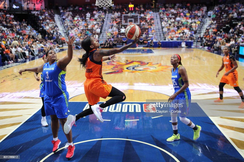 Courtney Williams #10 of the Connecticut Sun drives to the basket past Courtney Paris #3 of the Dallas Wings during the Connecticut Sun Vs Dallas Wings, WNBA regular season game at Mohegan Sun Arena on August 12th, 2017 in Uncasville, Connecticut.