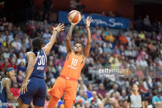 Courtney Williams of the Connecticut Sun shoots while defended by Tanisha Wright of the Minnesota Lynx during the Connecticut Sun Vs Minnesota Lynx...