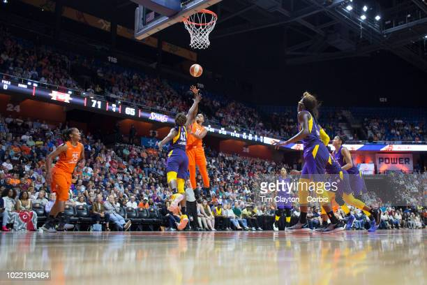 Courtney Williams of the Connecticut Sun shoots while defended by Jantel Lavender of the Los Angeles Sparks during the Connecticut Sun Vs Los Angeles...