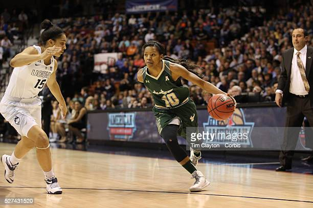 Courtney Williams USF drives past Gabby Williams UConn during the UConn Huskies Vs USF Bulls Basketball Final game at the American Athletic...