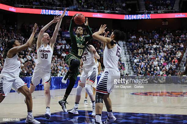 Courtney Williams USF drives to the basket defended by Morgan Tuck Breanna Stewart Katie Lou Samuelson and Gabby Williams UConn during the UConn...