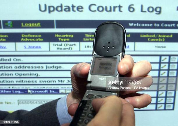 Courts minister Michael Wills at Chelmsford Crown Court launching a 24 million pilot project which will send mobile phone text messages to trial...